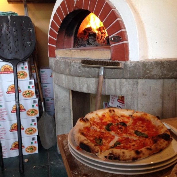 The wood-fired oven at Bosco pizzeria