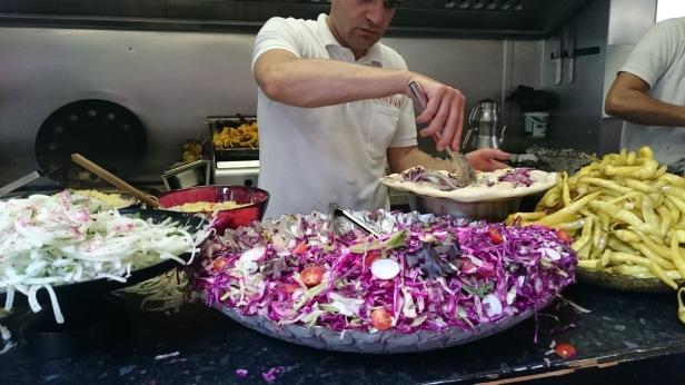 Piling the wraps high with salad at Matina