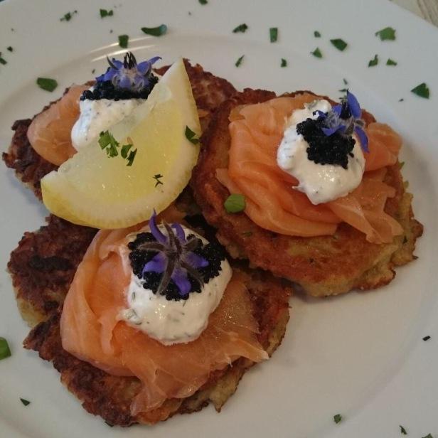 Latkes with smoked salmon, caviar & lovage at Aron's Jewish Deli