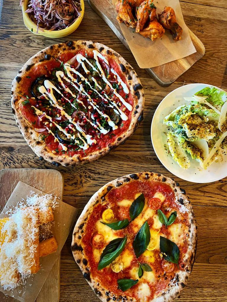 Pizzas and side dishes, polenta fries and salad