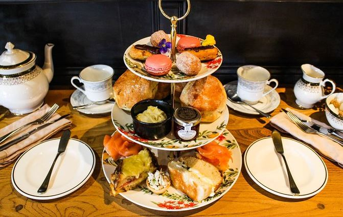 Afternoon tea with cakes and sandwiches
